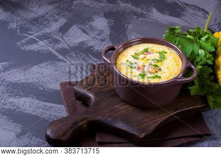 Chowder Soup With Corn, Bacon, Cream And Cheddar Cheese In A Ceramic Saucepan. American Cuisine Soup