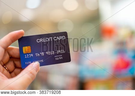 Using A Credit Card To Make Online Purchases Enjoy Shopping From Your Computer, Hand Holding Credit