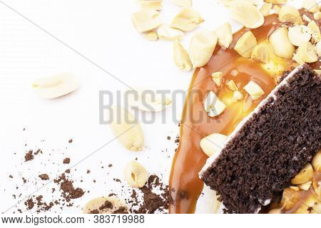 Delicious Cream-caramel Dessert With Peanuts On A White Background. Chocolate Chips And Caramel Smea