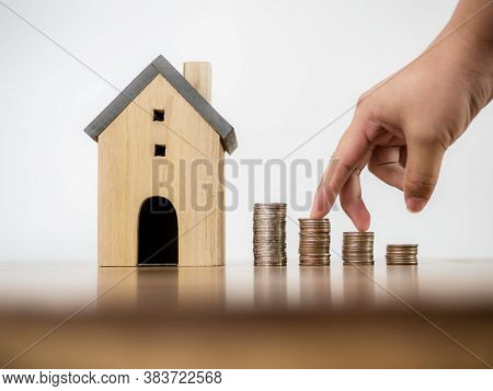 Fingers Hand Step Forward On Stack Of Coins And Model House On White Space Background Concept Busine