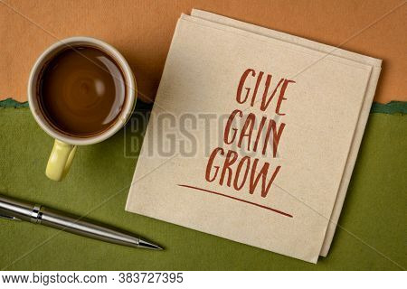 give, gain and grow - business and personal development concept - handwriting on a napkin with a cup of coffee