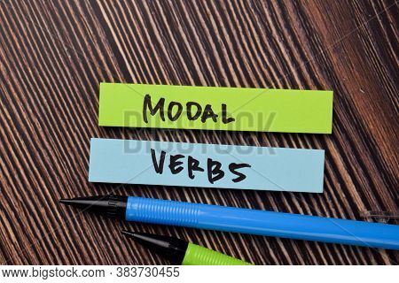 Modal Verbs Write On Sticky Notes Isolated On Office Desk.