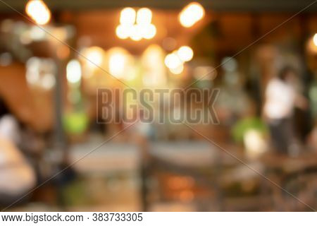 Abstract Blur Of Interior Inside Coffee Cafe Shop Background With Light Effect For Design Element. B