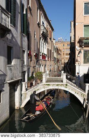 Venice, Italy - Febuary 22, 2020. Crowded Traffic Of Gondolas In Venice. Traffic Jam. Large Amounts