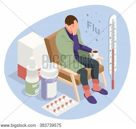 A Sick Upset Man With A Cup Of Tea, Sitting In A Chair Covered With A Blanket, Freezes And Has A Fev