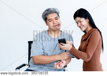 Asian Husband Who Is Patient From Nervous System And Paralysis Or Hemiplegia, Watching Applications