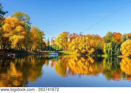 City Park. Autumn Scenery. Beautiful View Of Lake In The Park. Colorful Leaves On Trees. Reflection