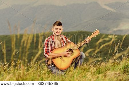 Inspiring Environment. Man With Guitar On Top Of Mountain. Acoustic Music. Summer Music Festival Out