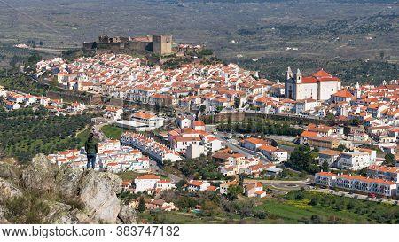 Woman Viewing Castelo De Vide From A Rock In Alentejo, Portugal From Serra De Sao Mamede Mountains