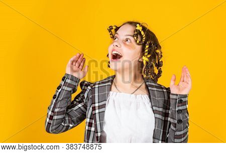 Perfect Beauty. Girl With Curlers And Hair Clips In Her Hair On Yellow Background. Little Girl Curle