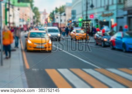Abstract Blurred Image Of Urban Street, Urban Traffic, Yellow Taxi, For Background. Auto, City Stree