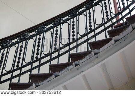 Vintage Forged Balusters Of A Spiral Staircase From Below, Beautiful Ladder Fencing