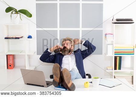 Drunk Man At The End Of The Working Day. Businessman Drink Beer In His Desk After An Office Party
