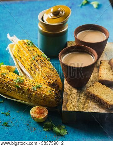 Top View Of Brewed Hot Milk Tea With Roasted Grilled Corn And Fresh Toast. Delicious Grilled Corncob