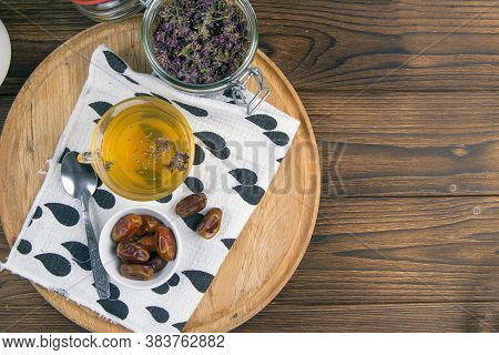 Tea With Mint In Arab Style And Dates On Wooden Table. Top Views With Clear Space.