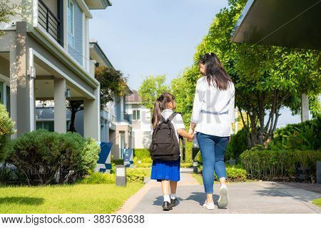 Happy Asian Mother And Daughter Primary School Student Walking To School In The Morning School Routi
