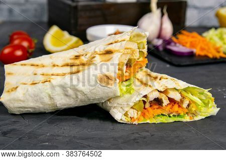 Homemade Shawarma, Burrito, Chicken Roll With Vegetables And Sauce. Top View Shawarma And Ingredient
