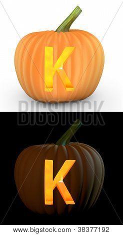 K Letter Carved On Pumpkin Jack Lantern