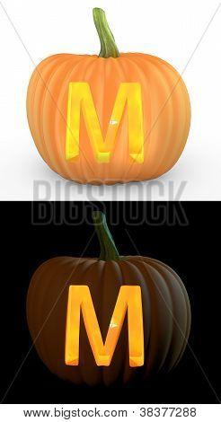 M Letter Carved On Pumpkin Jack Lantern