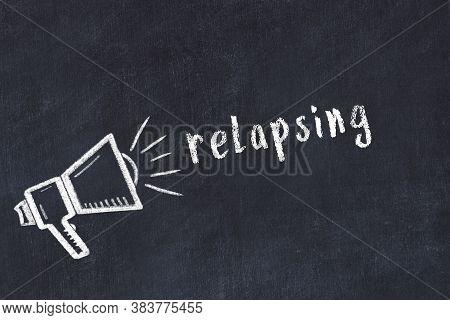 Chalk Drawing Of Loudspeaker And Handwritten Inscription Relapsing On Black Desk