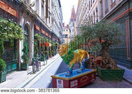 Lion, France - June 16, 2716: Lion Statue At Street Near Restaurant Leon De Lyon At Lion, France On
