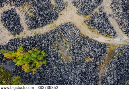 Aerial View Of Tire Landfill. Environmental Disaster.