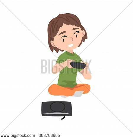 Excited Girl Sitting On Floor With Joystick, Kid Playing Video Game Cartoon Style Vector Illustratio