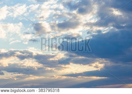 Clouds In Yellow Sunset Light. Blue Sky Background In The Evening