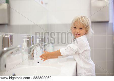 Little Preschool Child, Blond Boy, Washing Hands In Bathroom In Kindergarden