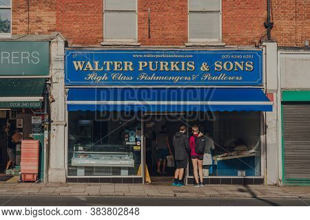 London, Uk - August 20, 2020: People Socially Distancing Queue Outside Walter Purkis & Sons Fishmong
