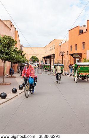 Marrakesh, Morocco - October 30, 2018: Moroccon Man Riding A Bike Near The Kasbah Of Marrakesh. The