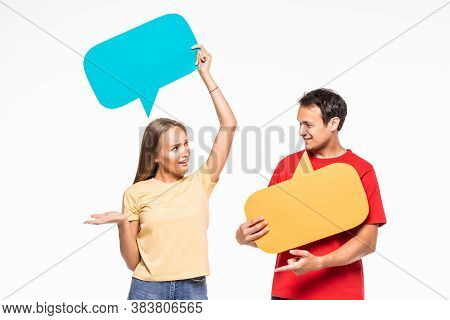 Portrait Of A Happy Young Couple Holding Empty Speech Bubbles Isolated Over White Background