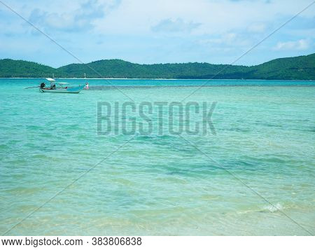 Longtail Boat On Crystal Clear Water On A Sunny Day In Koh Mudsum, Samui