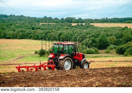 Tractor Plowing The Fields In The Countryside, Agricultural Tractor Plowing The Field