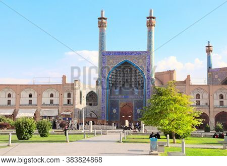 Imam Mosque on Naqsh-e Jahan Square (Shah Square, Imam Square), second biggest place of the world, Isfahan, Iran. UNESCO world heritage sites. The text above the arch is a quote from the Quran