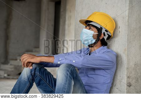 Head Shot Side View Of Construction Worker Seeing Outside From Construction Sites Or Industry Window