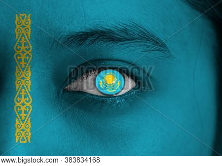 Human Face Painted Kazakhstan Flag With A Gold Sun Above Eagle On The Center Of Eye Or Eyeball. Huma