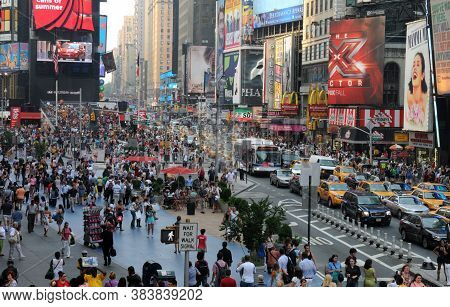 New York City, Usa, July 21 2011: Crowd Of People Walking In The Streets Of The Famous Times Square
