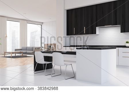 Corner Of Modern Kitchen With White And Black Walls, White Floor, White And Black Cupboards And Bar