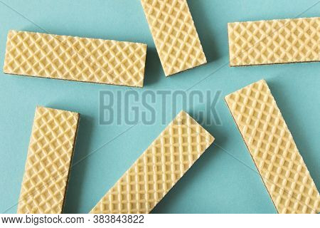 A Few Waffles With Chocolate On Blue  Background. Selective Focus
