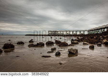 Dramatic morning lights on the beach with fishing pier