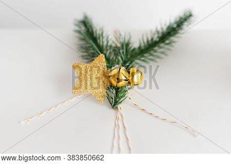 New Year Gift Wrapping With Gold Decoration And Tree Branches. Christmas Gifts, Preparation For The
