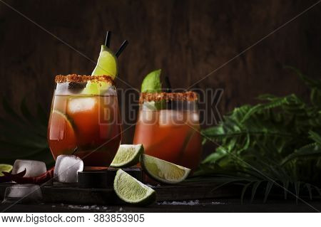 Michelada - Mexican Alcoholic Cocktail With Beer, Lime Juice, Tomato Juice, Spicy Sauce And Spices,