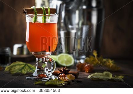 Hot Rum Punch, Autumn Or Winter Warming Alcoholic Cocktail With Dark Rum, Port, Honey, Lime Juice, B