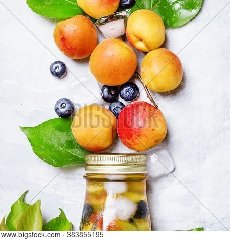 Apricot Ice Tea With Blueberry, Gray Stone Background, Top View