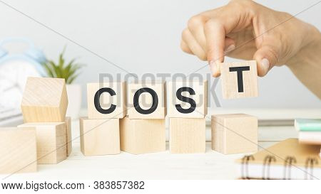 Cost, Expense Or Company Profit And Loss Concept, Cube Wooden Block With Alphabet Combine Word Cost