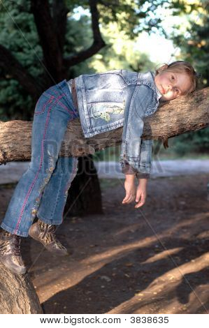Girl Sitting On The Tree