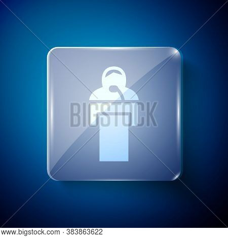 White Gives Lecture Icon Isolated On Blue Background. Stand Near Podium. Speak Into Microphone. The