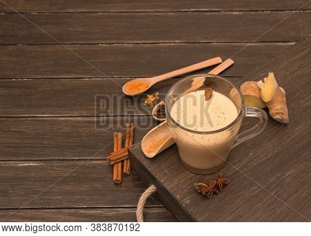 Hot Healthy Indian Masala Chai Or Tea With Diferent Spices (cardamon, Anice, Cinnamon, Ginger) On A
