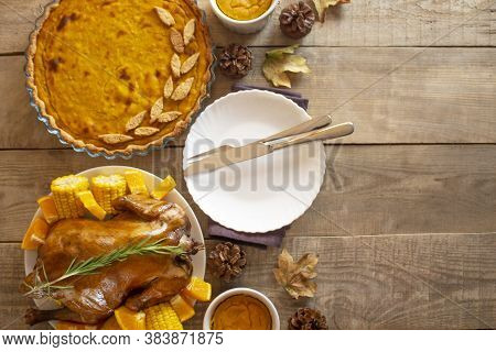 Thanksgiving Day. Thanksgiving Autumn Background Of Pumpkin Pie And Chicken. Thanksgiving. View From